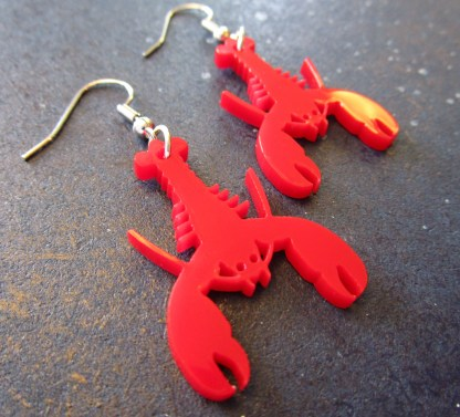 close up side view of Red Lobster Earring pendants with earring hooks