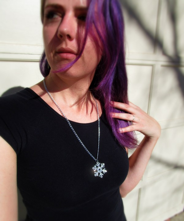 woman wearing glitter silver large snowflake pendant necklace