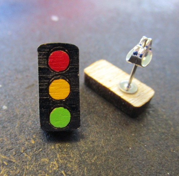 one traffic light earring facing forward, one upside down to show earring stud post and clutch back