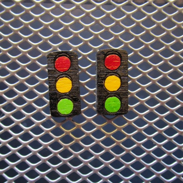 Tiny Traffic Stop Light Earrings on mesh background