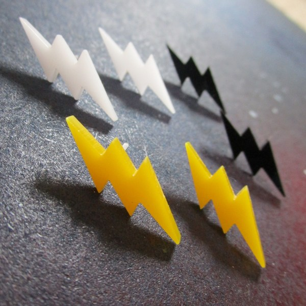 collection of small lightning bolt stud earrings in multiple colors