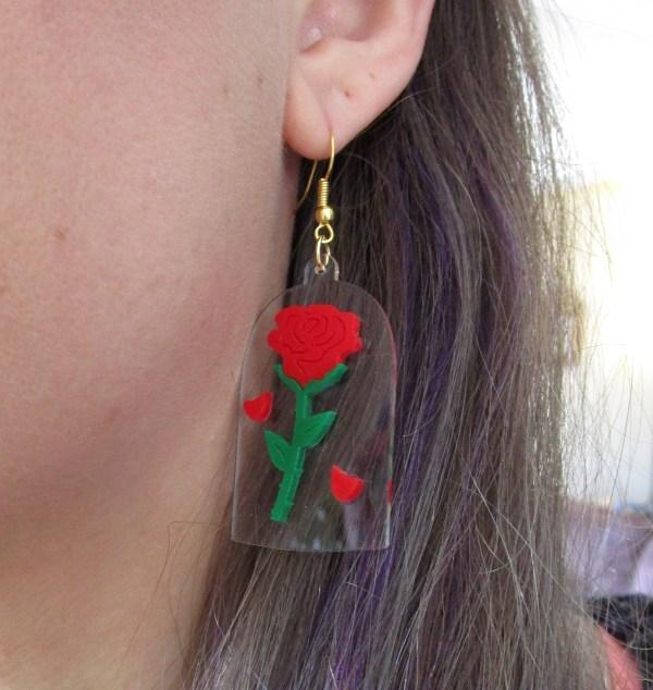 close of of woman ear earring enchanted rose earring