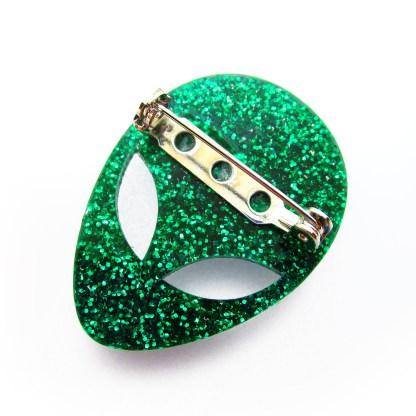 backside of glitter green alien brooch to show pin brooch latch