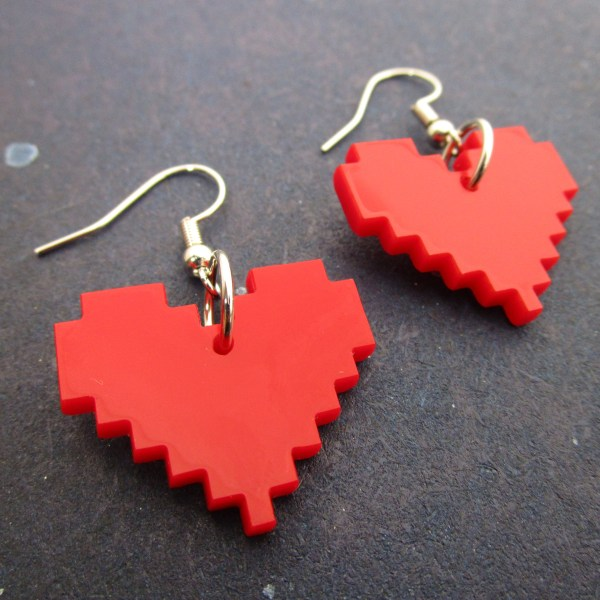 side view of red 8 bit pixel heart dangle earrings