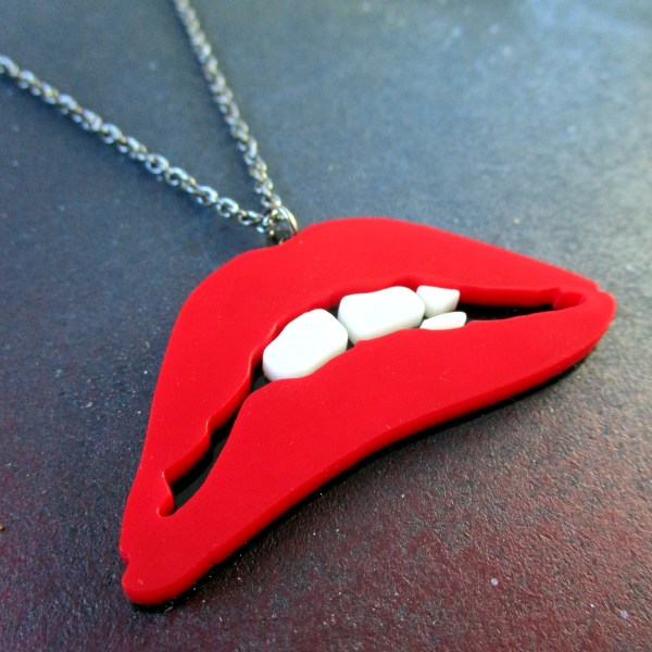 side view of red biting lips pendant