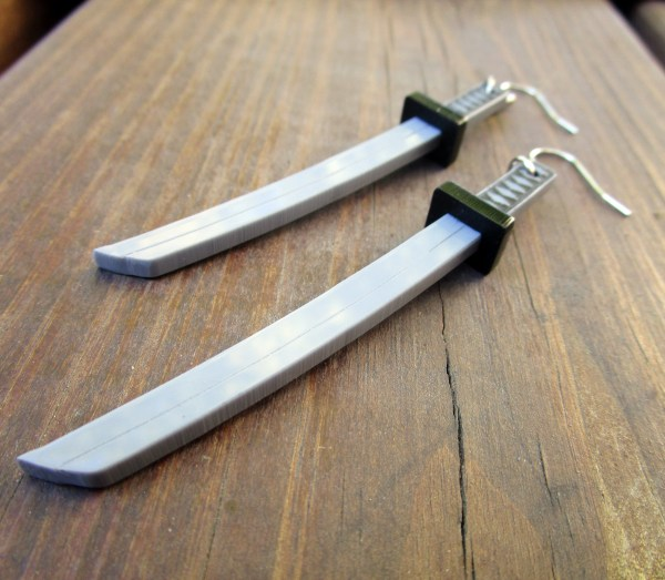 close up of side view of samurai sword katana dangle earrings