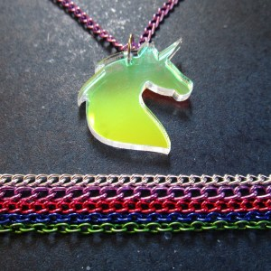 unicorn necklace pendant with lines of colored chain