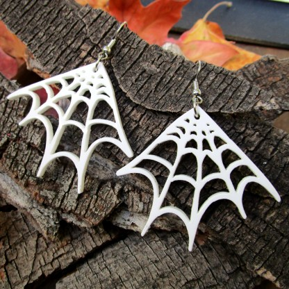 white spider web corner earrings on