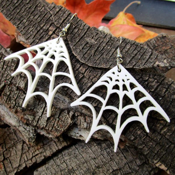 white spider web corner earrings on