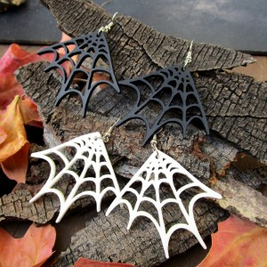 spider web earrings on wood and leaf background