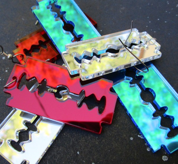 pile of colorful double sided razor blade pendants