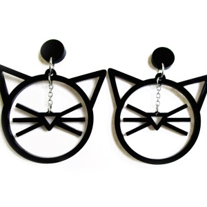 line art cat face dangle earrings on white background