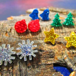 artistic picture of glitter christmas earring collection in glitter acrylic