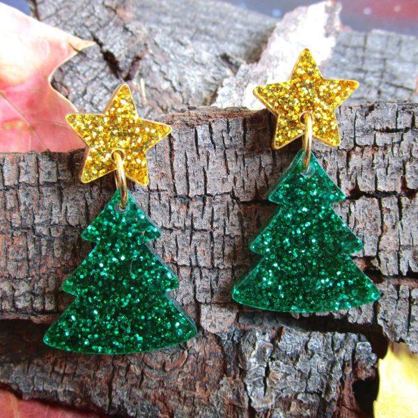 Glitter green christmas tree earrings on wood bark