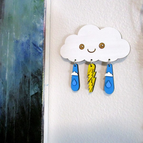 cute lightning rain cloud hanging on wall with earrings