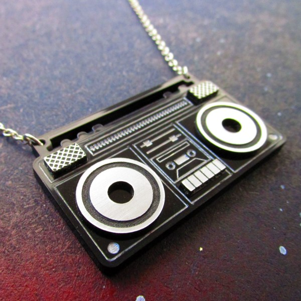 close up of laser cut acrylic boom box radio pendant necklace