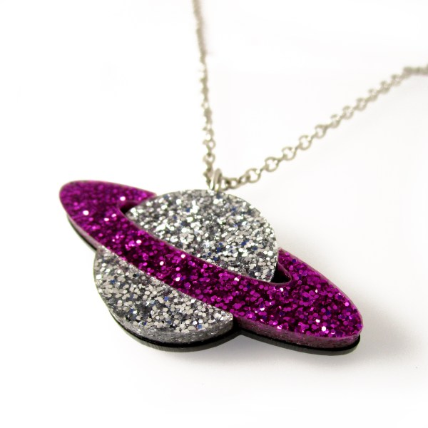 purple and silver planet necklace on white background