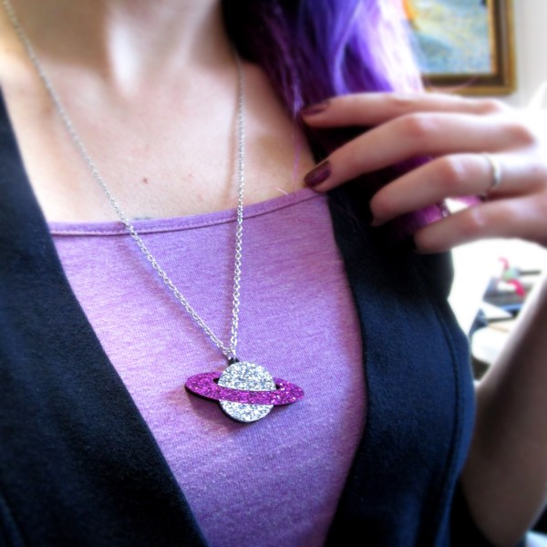 lady wearing purple planet necklace