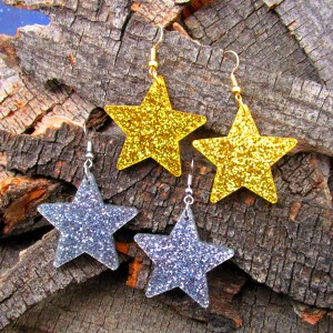glitter gold and silver big star dangle earring on wood