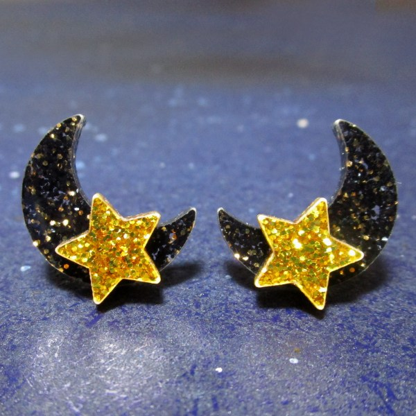 moon and star glitter stud earrings on space background