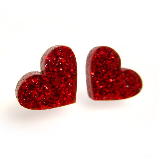 side view of 2 front facing glittery red heart earrings