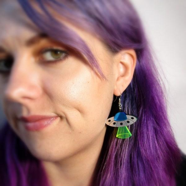 lady wearing ufo dangle earrings flying saucer alien spaceship