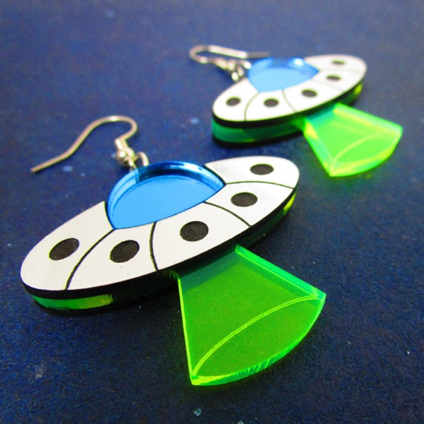 close up of ufo alien spaceship flying saucer earrings