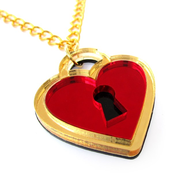 side view of mirrored gold and red key lock pendant necklace