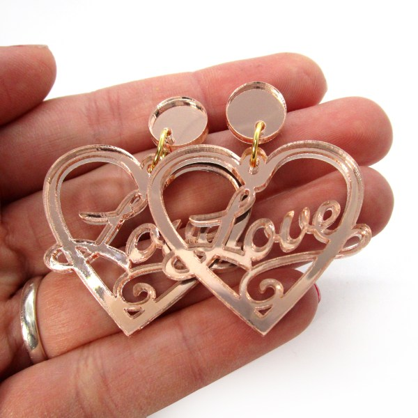 hand holding love word heart dangle earrings