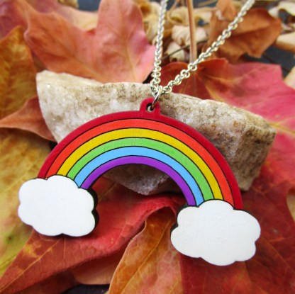 hand painted wood rainbow necklace on fall leaves background