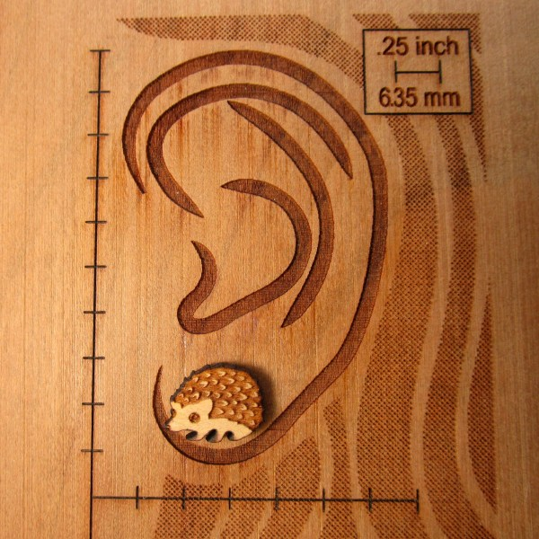 ear size chart with hedgehog earring to show size