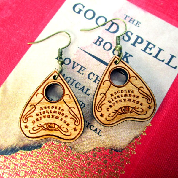 ouiji spirit board earrings on spell book
