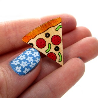 hand holding pizza pin brooch