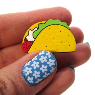 hand holding taco pin to show size