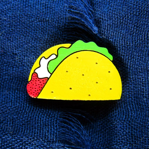 taco pin on blue fabric