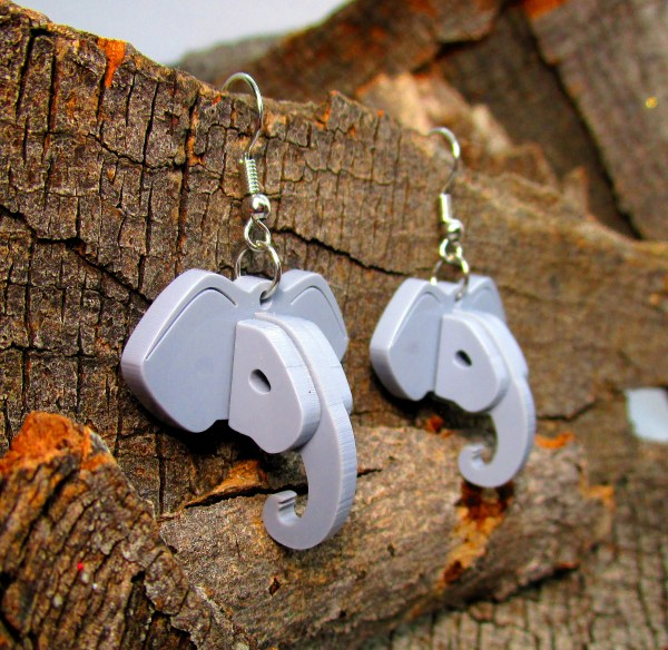 handmade elephant earrings on wooden background