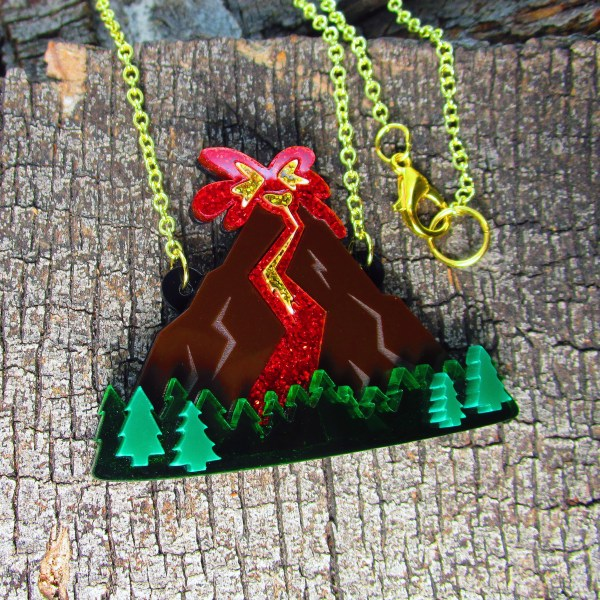 volcano shaped acrylic pendant necklace on wood background