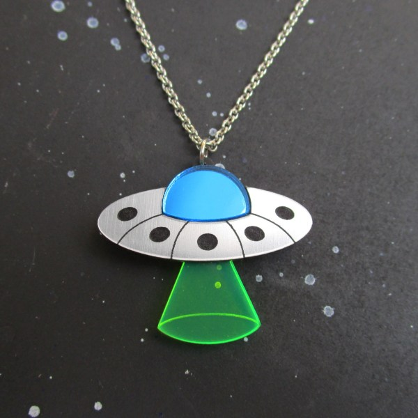 ufo saucer with beam on space background necklace