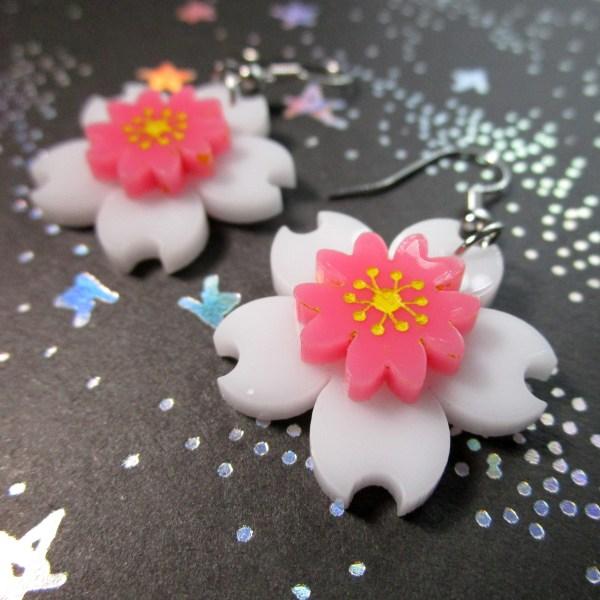 close up of white and pink sakura flower earrings set