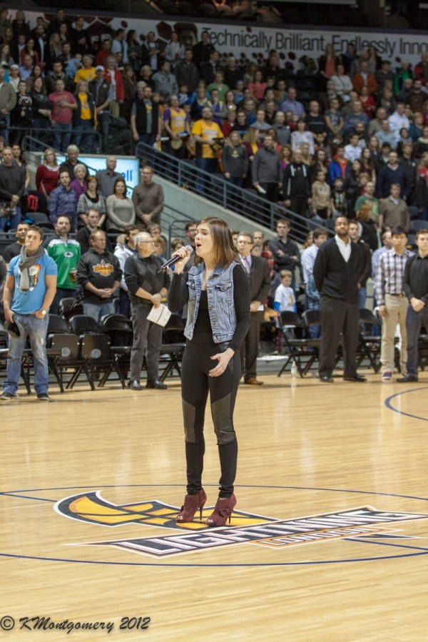 Melissa Megan performs the National Anthem for the NBL's London Lightning
