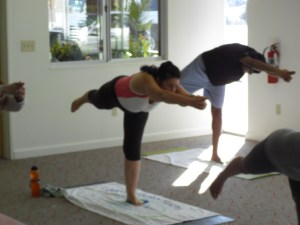 Hot Yoga Joyce on one foot.