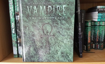 My copy of Vampire:the Masquerade 20th Anniversary Edition on one of my RPG shelves