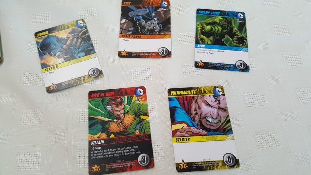 villain, punch, kick and vulnerability card in DC Deck building game