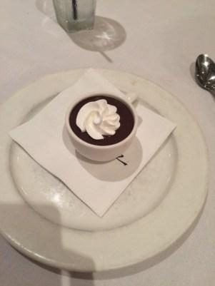 Rich dark chocolate custard garnished with whipped cream
