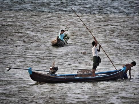 Fishermen around U Bein Bridge