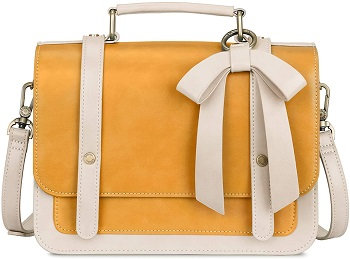 A yellow and white teenage purse with cute bow top handle and removable strap