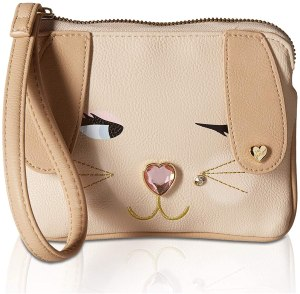 A skin and light pink color coin purse by Betsey Johnson a trendy teenage purse in 2021