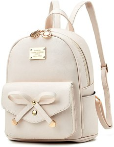 A Beige colored cute mini backpack for teenage girls with an adorable bow on its front pocket.