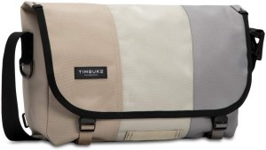 a smooth messenger bag for school and college with light skin, off white and grey color.