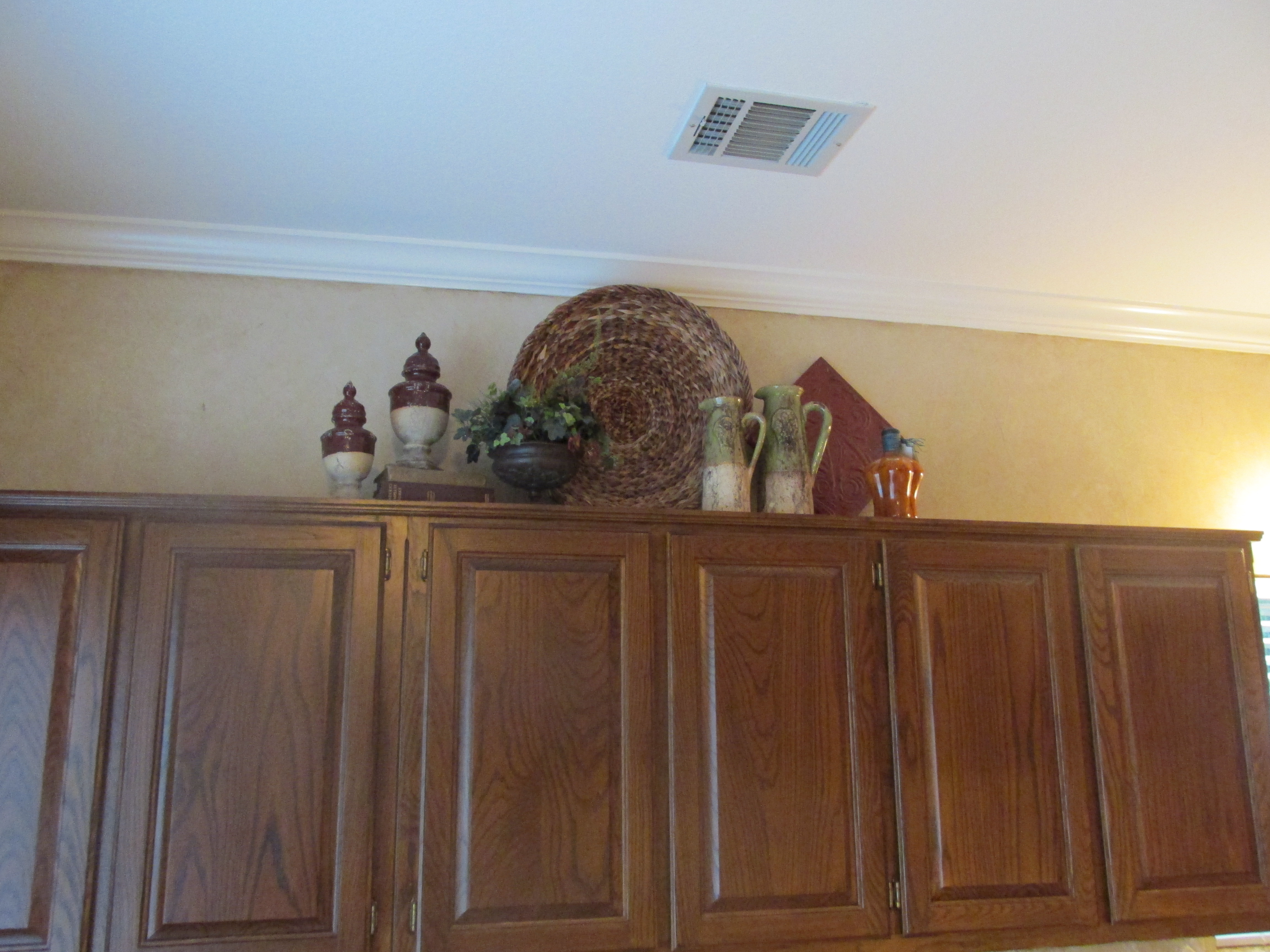 greenery above kitchen cabinets f the cabinetbefore and after  it 39s simply yours